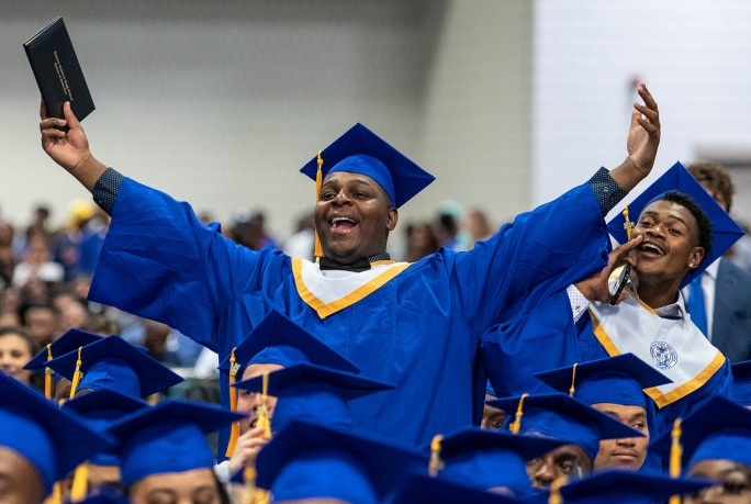 Seniors cheer for classmates during the 2019 commencement ceremonies for Eastern Guilford High School at the Greensboro Coliseum Special Events Center in Greensboro, N.C., on Saturday, June 8, 2019.