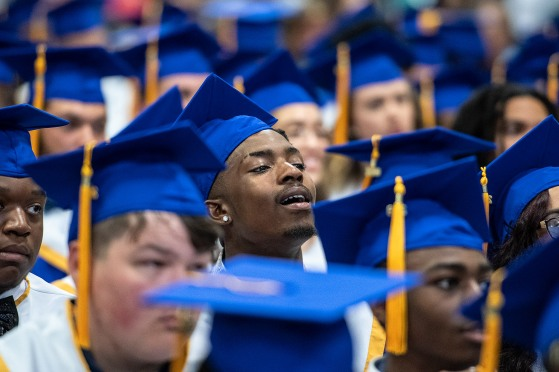 Seniors listen during the 2019 commencement ceremonies for Eastern Guilford High School at the Greensboro Coliseum Special Events Center in Greensboro, N.C., on Saturday, June 8, 2019.