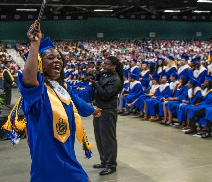 A senior yells to the crowd after receiving her diploma during the 2019 commencement ceremonies for Eastern Guilford High School at the Greensboro Coliseum Special Events Center in Greensboro, N.C., on Saturday, June 8, 2019.