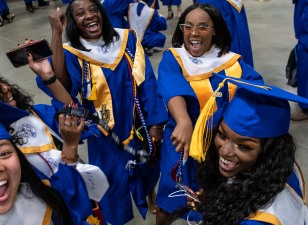 Maria Summers (upper right) dances with classmates before the 2019 commencement ceremonies for Eastern Guilford High School at the Greensboro Coliseum Special Events Center in Greensboro, N.C., on Saturday, June 8, 2019.