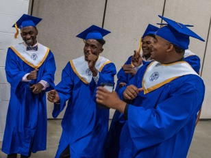 """Ethan Cooper (middle) and friends dance chanting, """"we made it,"""" before the 2019 commencement ceremonies for Eastern Guilford High School at the Greensboro Coliseum Special Events Center in Greensboro, N.C., on Saturday, June 8, 2019."""