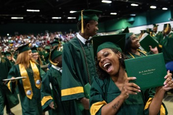 Daricka Anderson celebrates during the Recessional during the 2019 commencement ceremonies for Smith High School at the Greensboro Coliseum Special Events Center in Greensboro, N.C., on Saturday, June 8, 2019.